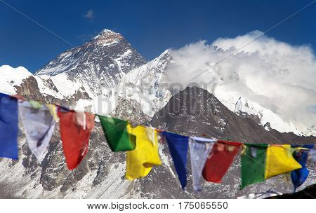himalaya view of himalayas mountains and Mount Everest Lhotse and Makalu with buddhist prayer flags from Gokyo Ri - Nepal