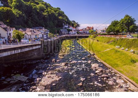 Lynmouth Devon England 13 July 2016: West Lyn River merges with the East Lyn River and is committed to the sea. Houses and Bridge on the left bank.