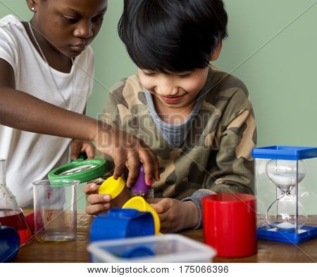 Students studying scientific experiment research