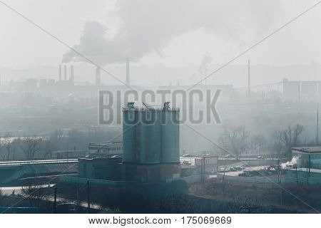 Morning, fog, smog, dirty polluted industrial area, Smokesting pipes of plants