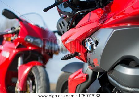 Senta Serbia: March 4th 2017. Closeup of beautiful BMW K1300R motorcycle photographed outdoor on a dock in Senta besides river. Ducati 996s in the back.