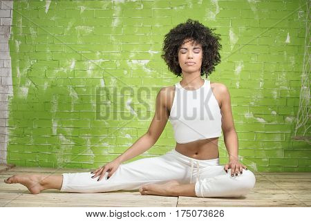 Young Afro Girl Meditating.