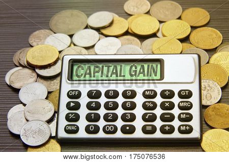 coins and silver calculator with text on display-capital gain