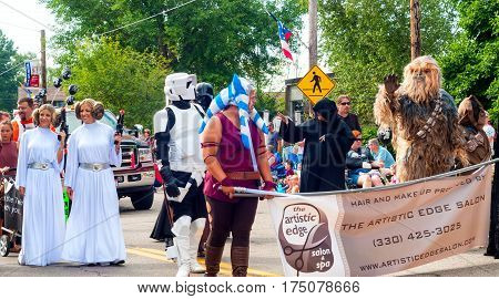 TWINSBURG OH USA - AUGUST 8 2015: Twins and others dressed as characters from Star Wars walk in the Double Take Parade part of the 40th annual Twins Day festival the largest gathering of twins in the world.