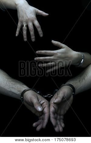 Woman embracing his handcuffed husband who has been a reprobate.