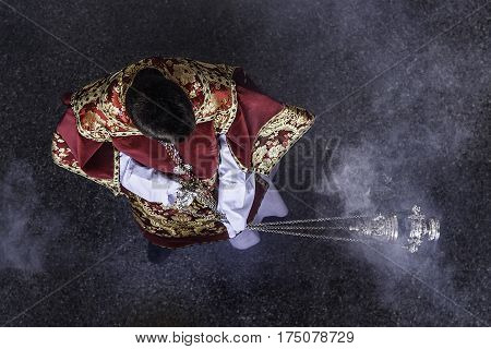 Acolyte moving a censer.The Acolyte in the catholic Church, is the person who helps the priest in the altar and can administer the Eucharist