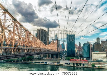 NEW YORK CITY, USA - AUGUST 12, 2016: The Queensboro Bridge is a two-level double cantilever bridge. It has two cantilever spans, one over the channel on each side of Roosevelt Island. Vivid image.