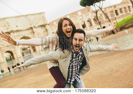 Loving Couple In Front Of Colosseum In Rome