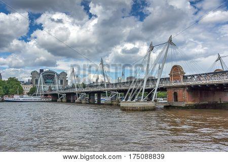 LONDON, ENGLAND - JUNE 15 2016: Hungerford Bridge and Thames River, London, England, United Kingdom