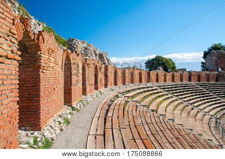Section of the upper external arcade of the greek theater and a view of its bleachers Taormina East Sicily
