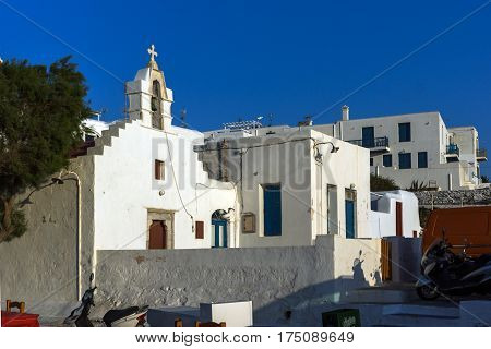 White orthodox church and small bell tower in Mykonos, Cyclades Islands, Greece