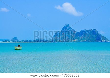 Beach and tropical sea with long-tail boat in thailand