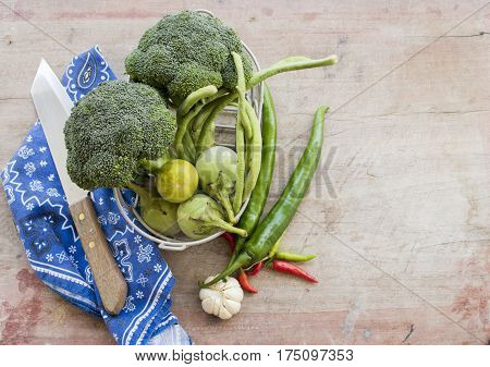 fresh vegetable prepared to cook on table wood
