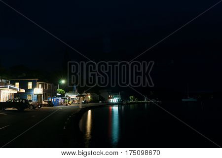 Mangonui, New Zealand- February 13, 2017; Small New Zealand coastal town main street at dusk Mangonui
