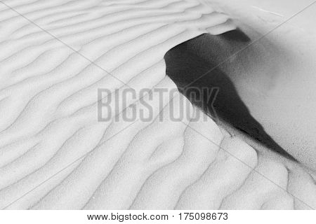 Monochrome abstract sand patterns to sharp edge and shadows