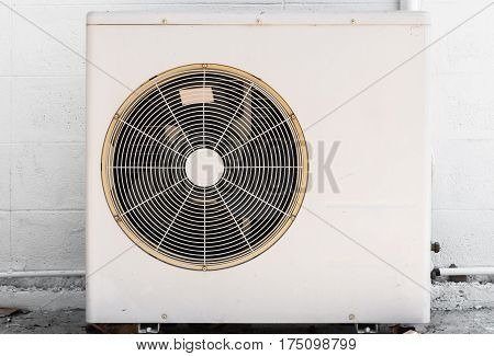 Closeup to White Outdoor Air Conditioner Compresser