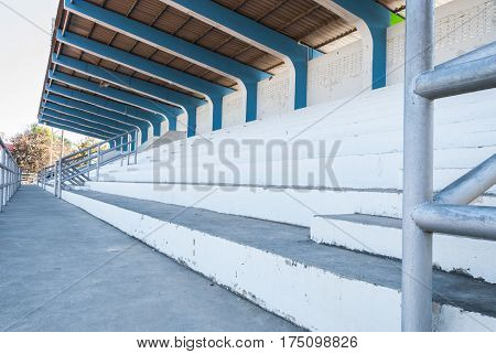 Closeup To Small White And Blue Grandstand In Stadium Area