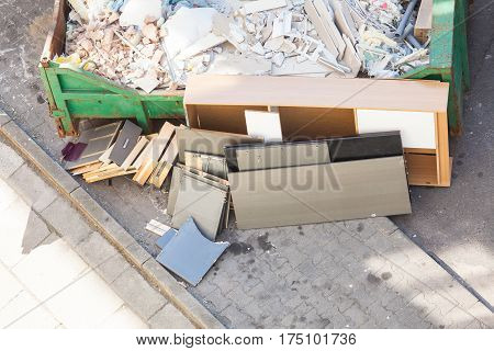 Bulky waste messy trash in container mess after renovation outdoor shot