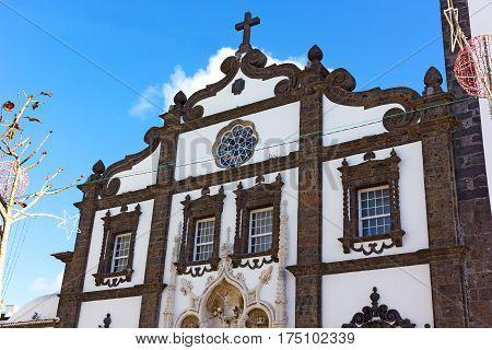 Facade of Saint Sebastian church in Ponta Delgada Azores Portugal. Main Church of Azores archipelago capital with Christmas decorations.