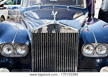 RUSSIA MOSCOW - April 24.2016: Hood of old rarity of the English car with an emblem Rolls-Royce. Exhibition of ancient cars