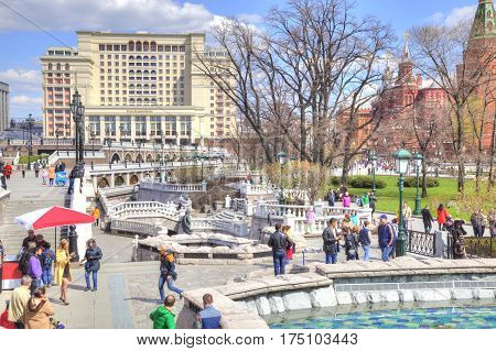 MOSCOW RUSSIA - April 24.2016: People walk past the Alexander Garden fountains in the historic center of city