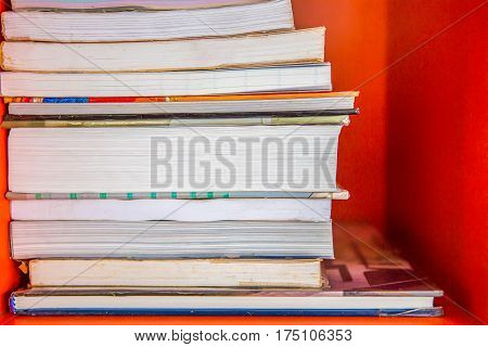 Book Shelf with Stack of No Cover Books