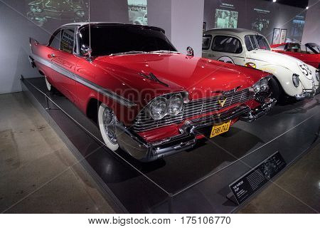 Los Angeles CA USA - March 4 2017: Red 1958 Plymouth Fury stunt car from the movie Christine from the collection of Martin Sanchez at the Petersen Automotive Museum in Los Angeles California United States. Editorial only.