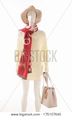 female sundress clothing with hat and scarf with handbag on mannequin