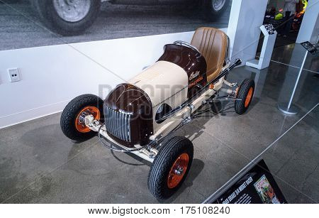 Los Angeles CA USA - March 4 2017: Tan 1948 Drake three fourth Midget Racer with an Indian engine at the Petersen Automotive Museum in Los Angeles California United States. Editorial only