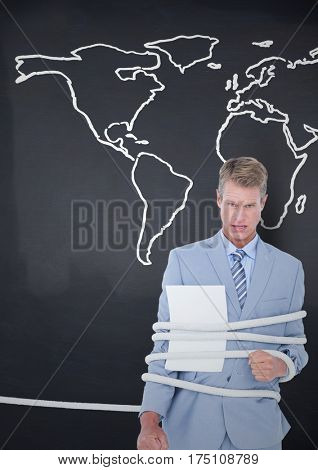 Digital composite image of businessman tied up in rope against world map