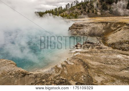Close-up of Excelsior Geyser in Yellowstone National Park as the wind shifts and blows some of the steam away