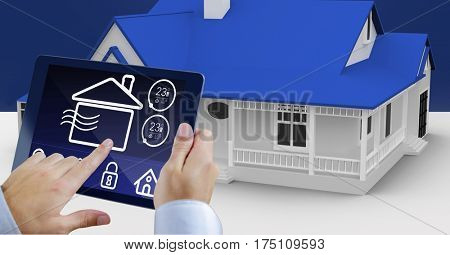 Digital generated image of hands using digital tablet with home security icons