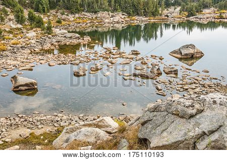 Calm lake with rocks and nice reflections along the Beartooth Highway