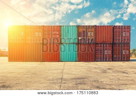 Handling stack of container shipping with sunshine. Transportation business.