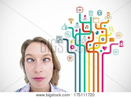 Digital composite image of squint eyed woman standing against application icons
