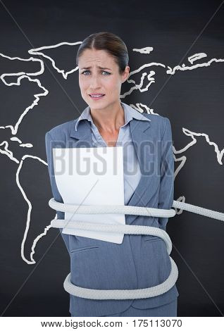 Digital composite image of businesswoman tied up in rope against world map