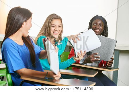 Interracial group of girls have fun at school
