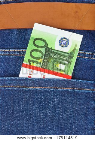 Money in jeans pocket - shopping background