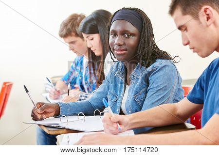 African student taking a difficult test in university