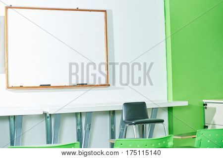 Classroom with empty blackboard and chairs at a University