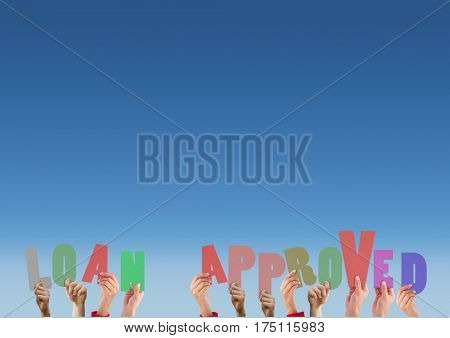 Hands holding alphabets that read loan approved against blue background