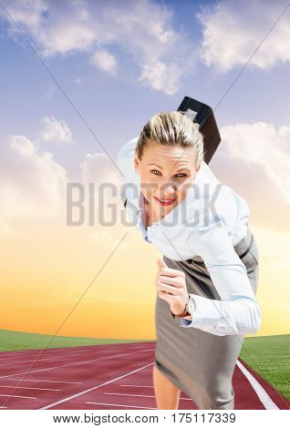 Composite image of businesswoman with briefcase running on race track