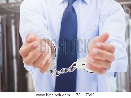 Composite image of corrupt businessman in hand cuffs