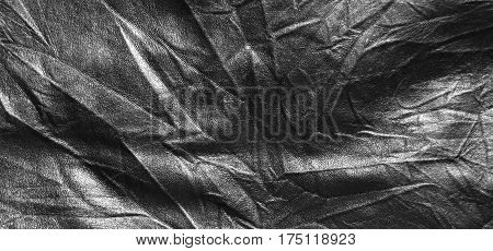 Surface of black leatherette texture for background.