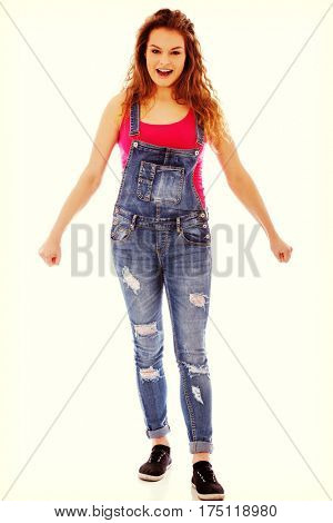 Angry screaming young woman with clenched fist