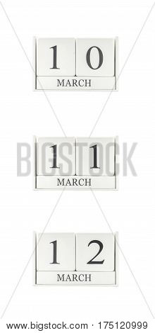 Closeup group of white wooden calendar with black 10 11 12 march word three date calendar isolated on white background