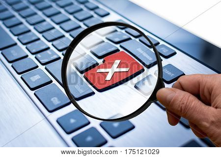 Keyboard of computer or laptop with red key with cross