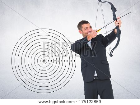 Digital composition of businessman aiming at the target board against grey background