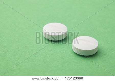 Pills over a green background. Medicament treatment. Health care photo