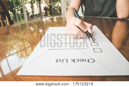 Working Woman  Hand Holding Pen On Check List Paper With Tablet In Vintage Style.